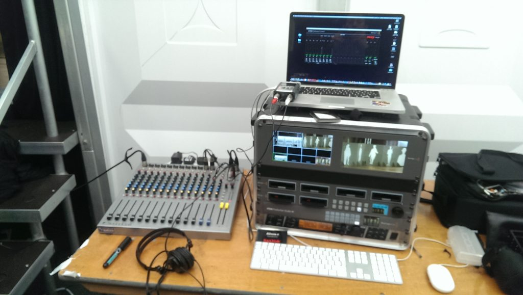 A photo from behind the scenes of a live streaming gig